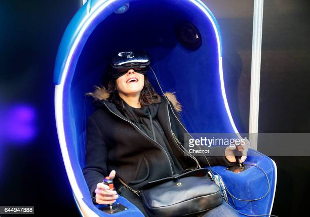 A visitor plays a video game with a reality virtual headset to experience 3D virtual reality during the show 'Virtuality Paris 2017' on February 24...