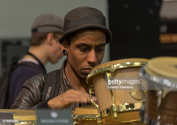 A visitor plays bongoes at LP stand in the Musikmesse 2014 music international trade fair in Frankfurt Germany 12 March 2014 The Musikmesse is the...