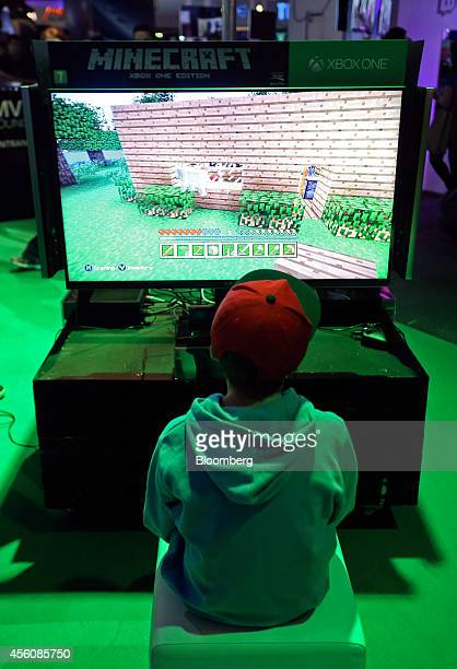 A visitor plays the Minecraft computer came produced by Mojang AB on a Microsoft Corp Xbox One games console during the EGX gaming conference at...