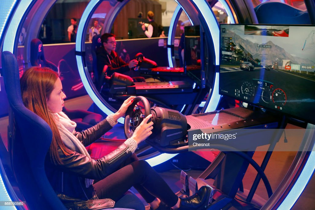 A visitor plays the video game 'Gran Turismo Sport' developed by Polyphony Digital and published by Sony Interactive Entertainment on Sony PlayStation game consoles PS4 Pro during the 'Paris Games Week' on October 31, 2017 in Paris, France. 'Paris Games Week' is an international trade fair for video games to be held from October 31 to November 5, 2017.