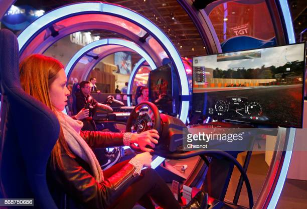 A visitor plays the video game Gran Turismo Sport developed by Polyphony Digital and published by Sony Interactive Entertainment on Sony PlayStation...