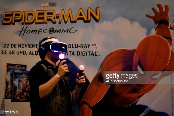 A visitor plays with virtual reality glasses during the Madrid Comics Con on November 10 2017 at the Feria de Madrid The 2017 edition of the Madrid...