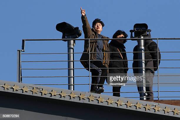 A visitor points towards the north side of the border at the Imjingak pavilion near the demilitarized zone in Paju South Korea on Sunday Feb 7 2016...