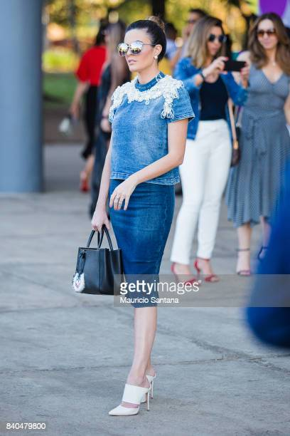 A visitor poses during Sao Paulo Fashion Week N44 SPFW Winter 2018 at Ibirapuera's Bienal Pavilion on August 28 2017 in Sao Paulo Brazil