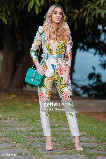 A visitor poses during Sao Paulo Fashion Week N44 SPFW Winter 2018 at Ibirapuera's Bienal Pavilion on August 29 2017 in Sao Paulo Brazil