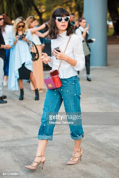 A visitor poses during Sao Paulo Fashion Week N44 SPFW Winter 2018 at Ibirapuera's Bienal Pavilion on August 30 2017 in Sao Paulo Brazil