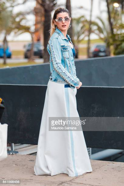 A visitor poses during Sao Paulo Fashion Week N44 SPFW Winter 2018 at Ibirapuera's Bienal Pavilion on August 31 2017 in Sao Paulo Brazil