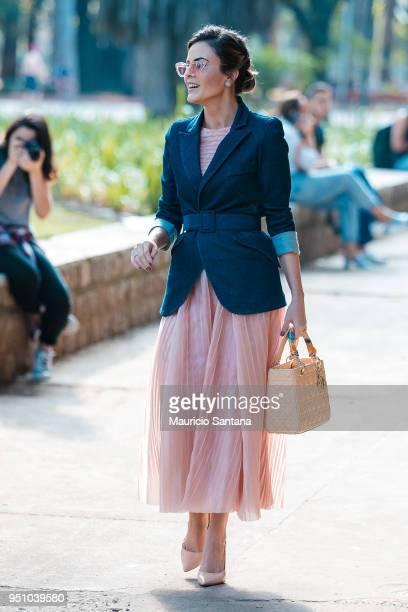 A visitor poses during Sao Paulo Fashion Week N45 SPFW Summer 2019 at Brazilian Cultures Engineer Armando de Arruda Pereira Pavilion on April 24 2018...