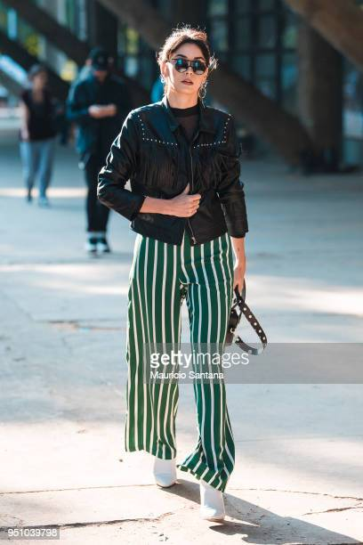 A visitor poses during Sao Paulo Fashion Week N45 SPFW Summer 2019 at Brazilian Cultures Engineer Armando de Arruda Pereira Pavilion on April 24 2018...