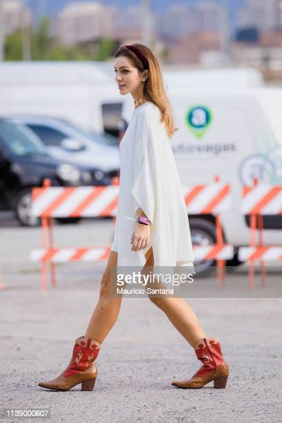 A visitor poses during Sao Paulo Fashion Week N47 SPFW Summer 2020 at ARCA on April 23 2019 in Sao Paulo Brazil