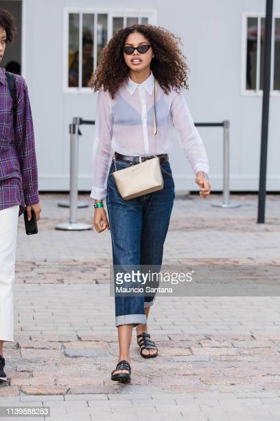 A visitor poses during Sao Paulo Fashion Week N47 SPFW Summer 2020 at ARCA on April 26 2019 in Sao Paulo Brazil