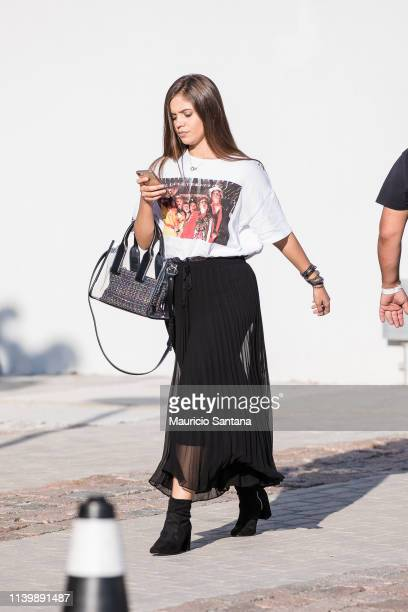 A visitor poses during Sao Paulo Fashion Week N47 SPFW Summer 2020 at ARCA on April 27 2019 in Sao Paulo Brazil
