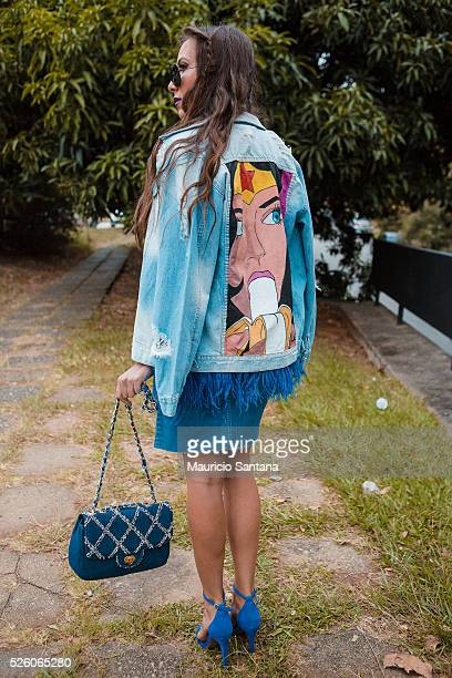A visitor poses during Sao Paulo Fashion Week Summer 2017 SPFW at Ibirapuera's Bienal Pavilion on April 28 2016 in Sao Paulo Brazil