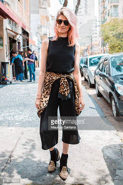A visitor poses during Sao Paulo Fashion Week Trans 42 SPFW Fall / Winter 2017 on October 26 2016 in Sao Paulo Brazil