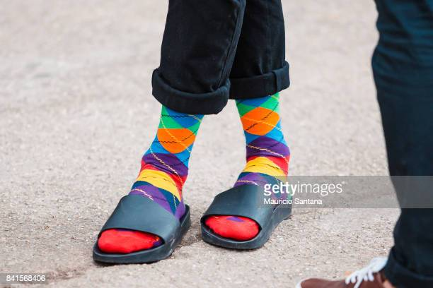 A visitor poses fashion detail colorful socks during Sao Paulo Fashion Week N44 SPFW Winter 2018 at Ibirapuera's Bienal Pavilion on August 31 2017 in...