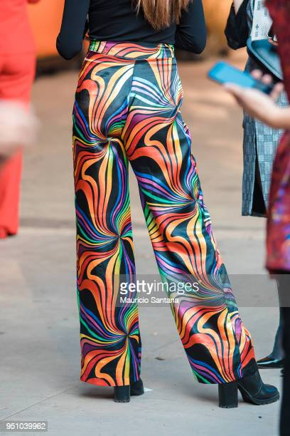 A visitor poses fashion detail coloured pants during Sao Paulo Fashion Week N45 SPFW Summer 2019 at Brazilian Cultures Engineer Armando de Arruda...