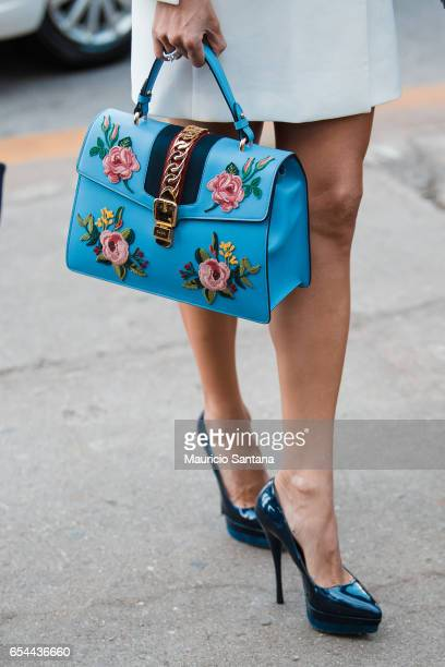 A visitor poses fashion detail hand bag during Sao Paulo Fashion Week N43 SPFW Fall/Winter 2017 on March 16 2017 in Sao Paulo Brazil