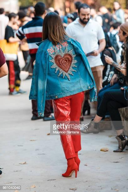 A visitor poses fashion detail jacket follow me during Sao Paulo Fashion Week N45 SPFW Summer 2019 at Brazilian Cultures Engineer Armando de Arruda...