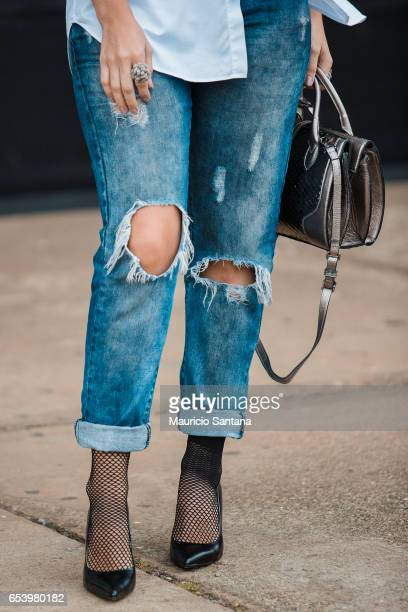 Visitor poses, fashion detail jeans and shoes, during Sao Paulo Fashion Week N43 SPFW Summer 2017 on March 15, 2017 in Sao Paulo, Brazil.