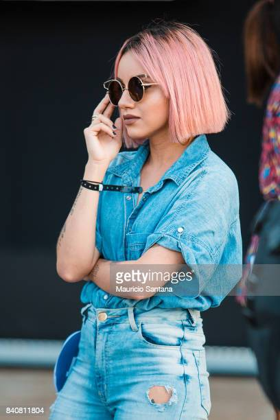 A visitor poses fashion detail pink hair and sunglass during Sao Paulo Fashion Week N44 SPFW Winter 2018 at Ibirapuera's Bienal Pavilion on August 29...