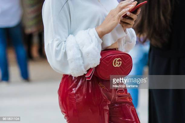 A visitor poses fashion detail purse during Sao Paulo Fashion Week N45 SPFW Summer 2019 at Brazilian Cultures Engineer Armando de Arruda Pereira...