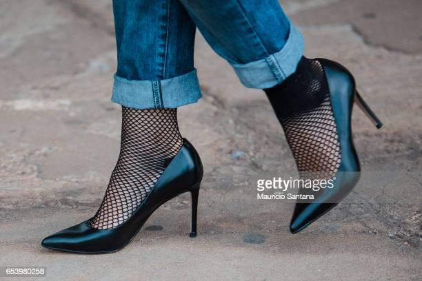 Visitor poses, fashion detail shoes, during Sao Paulo Fashion Week N43 SPFW Summer 2017 on March 15, 2017 in Sao Paulo, Brazil.