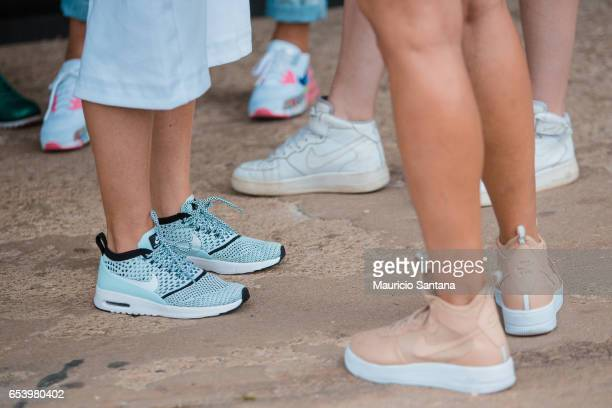 A visitor poses fashion detail shoes during Sao Paulo Fashion Week N43 SPFW Summer 2017 on March 15 2017 in Sao Paulo Brazil