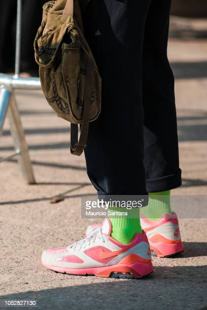 A visitor poses fashion detail shoes during Sao Paulo Fashion Week N46 SPFW Winter 2019 at ARCA on October 22 2018 in Sao Paulo Brazil