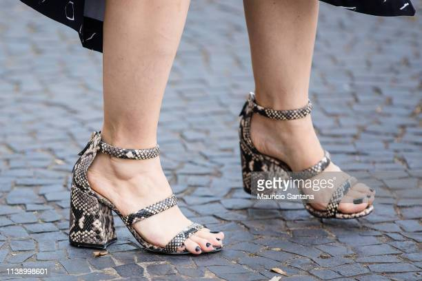 A visitor poses fashion detail shoes during Sao Paulo Fashion Week N47 SPFW Summer 2020 at ARCA on April 23 2019 in Sao Paulo Brazil