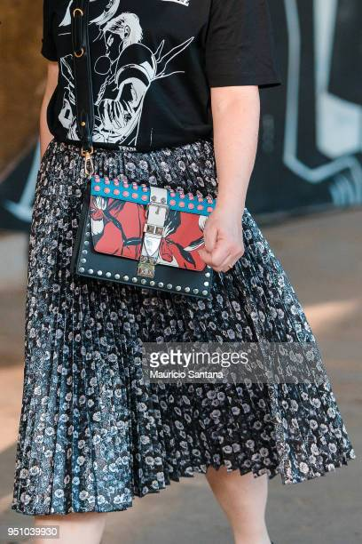 A visitor poses fashion detail shoulder bag during Sao Paulo Fashion Week N45 SPFW Summer 2019 at Brazilian Cultures Engineer Armando de Arruda...