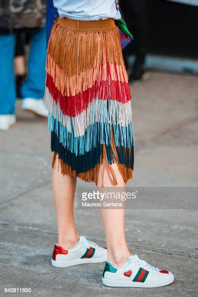 A visitor poses fashion detail skirt and shoes during Sao Paulo Fashion Week N44 SPFW Winter 2018 at Ibirapuera's Bienal Pavilion on August 29 2017...