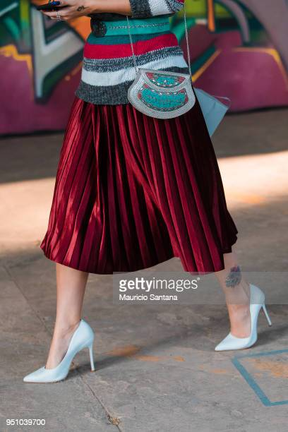 A visitor poses fashion detail skirt and shoulder bag during Sao Paulo Fashion Week N45 SPFW Summer 2019 at Brazilian Cultures Engineer Armando de...