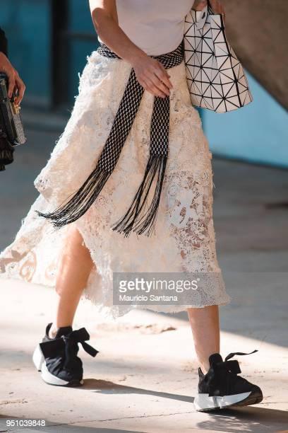 A visitor poses fashion detail skirt during Sao Paulo Fashion Week N45 SPFW Summer 2019 at Brazilian Cultures Engineer Armando de Arruda Pereira...