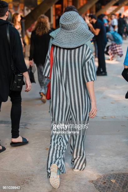 A visitor poses fashion detail striped dress and hat during Sao Paulo Fashion Week N45 SPFW Summer 2019 at Brazilian Cultures Engineer Armando de...