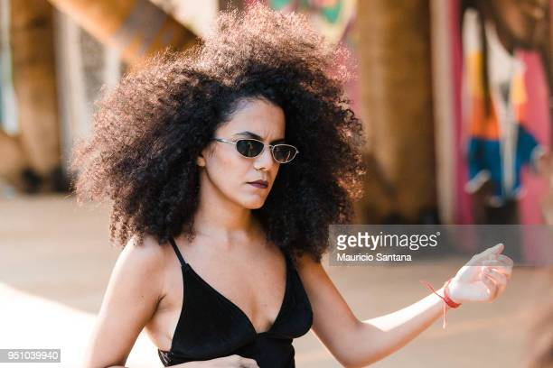 A visitor poses fashion detail sunglasses and hairstyle during Sao Paulo Fashion Week N45 SPFW Summer 2019 at Brazilian Cultures Engineer Armando de...