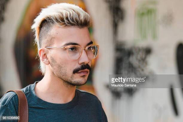 A visitor poses fashion detail sunglasses and mustache during Sao Paulo Fashion Week N45 SPFW Summer 2019 at Brazilian Cultures Engineer Armando de...