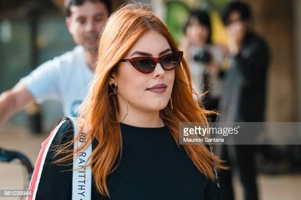 A visitor poses fashion detail sunglasses during Sao Paulo Fashion Week N45 SPFW Summer 2019 at Brazilian Cultures Engineer Armando de Arruda Pereira...