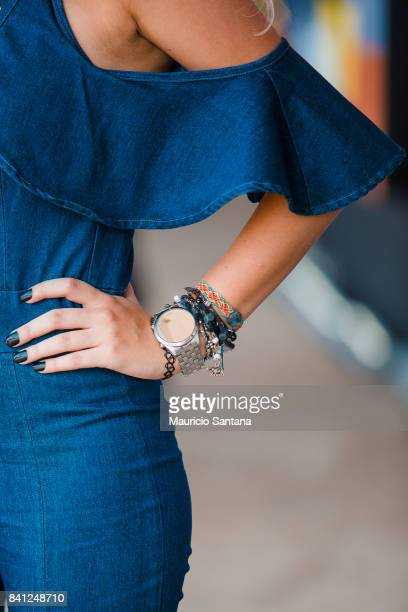 A visitor poses fashion detail wristwatch and bracelets during Sao Paulo Fashion Week N44 SPFW Winter 2018 at Ibirapuera's Bienal Pavilion on August...