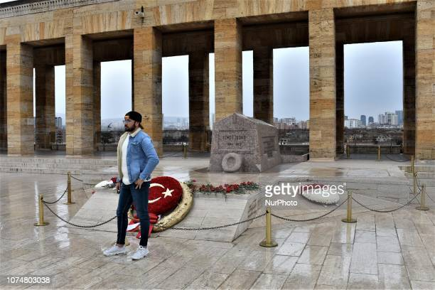 A visitor poses for a photograph in front of the tomb of Ismet Inonu modern Turkey's second president and successor to Mustafa Kemal Ataturk at...