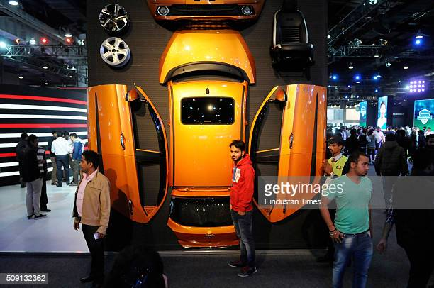 Visitor poses on a display at the Auto Expo 2016 on February 8, 2016 in Greater Noida, India. People thronged at the Auto Expo 2016 venue for the...