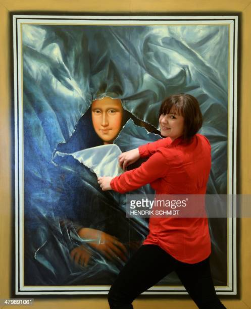 A visitor poses with the interactive 3D painting 'Mona Lisa' at the exhibition 'Du bist die Kunst' of a ChineseKorean artists group at Augustusburg...