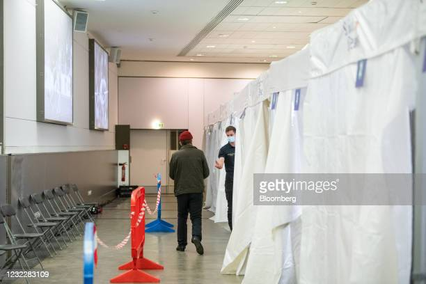 Visitor prepares to receive a Pfizer-BioNTech Covid-19 vaccine at the Stade de France vaccination center in Paris, France, on Tuesday, April 13,...