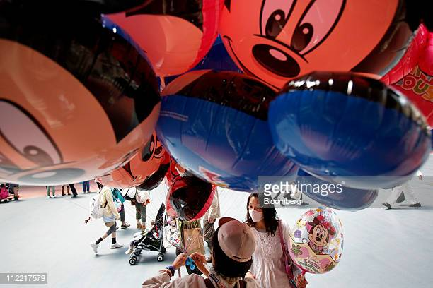 A visitor purchases a balloon featuring the Walt Disney Co character Minnie Mouse at Tokyo Disneyland operated by Oriental Land Co in Urayasu city...