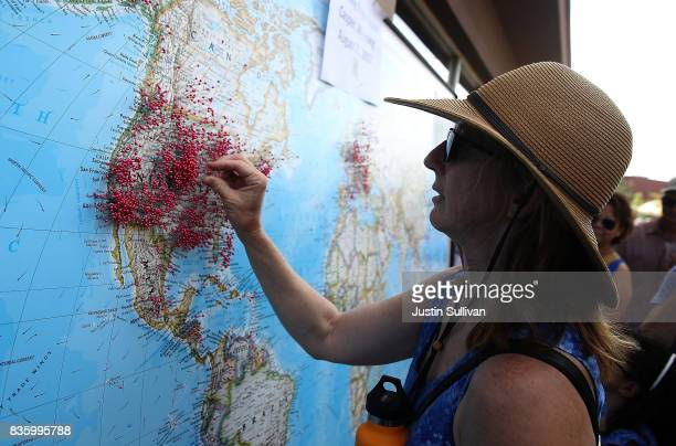 A visitor puts a pin on map to show where she is visiting from during the Wyoming Eclipse Festival on August 20 2017 in Casper Wyoming Thouands of...