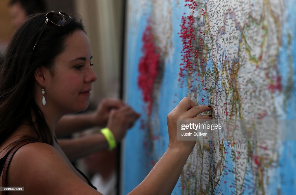 A visitor puts a pin on map to show where she is visiting from during the Wyoming Eclipse Festival on August 20, 2017 in Casper, Wyoming. Thouands of people have descended on Casper, Wyoming to see the solar eclipse in the path of totality as it passes over the state on August 21.