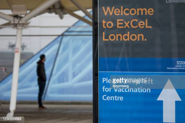 Visitor queues outside a Covid-19 vaccination centre at the ExCel convention centre in London, U.K., on Monday, Jan. 11, 2021. The U.K. Said its...