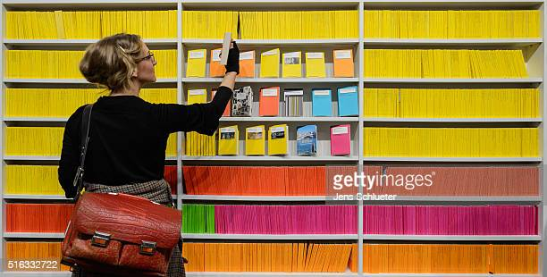 Visitor reaches for a book during the Leipzig Book Fair 2016 on March 18, 2016 in Leipzig, Germany. From March 17 to March 20 more than 2000...