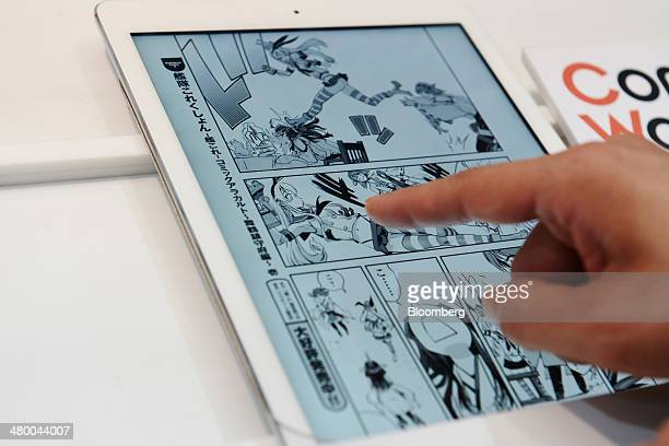A visitor read manga comics through the 'Comic Walker' app on a touch panel at a booth at Tokyo Big Sight East Exhibition Halls during the AnimeJapan...