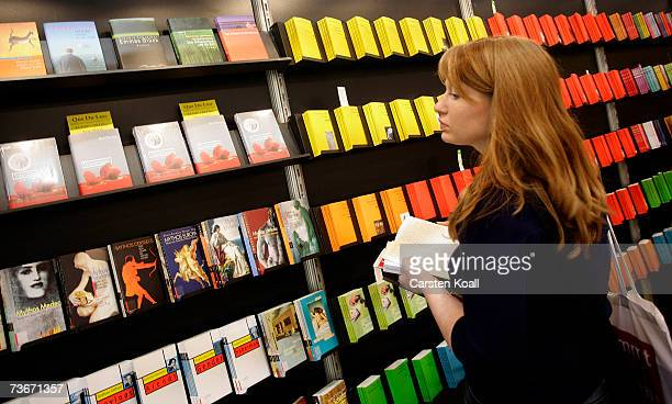 A visitor reads a book at the exhibition booth at the book fair March 22 2007 in Leipzig Germany Some 2348 exhibitors from 36 nations present their...