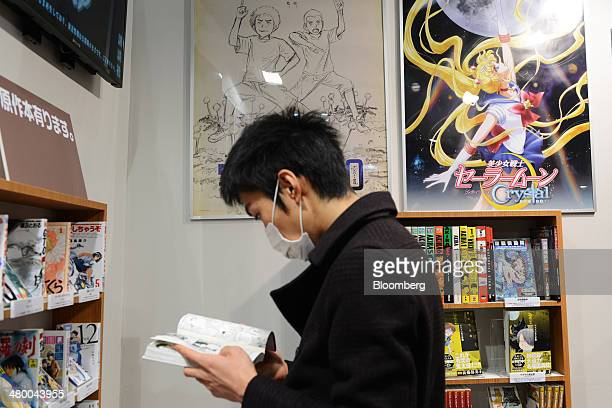 A visitor reads a manga book at Tokyo Big Sight East Exhibition Halls during the AnimeJapan 2014 convention in Tokyo Japan on Saturday March 22 2014...